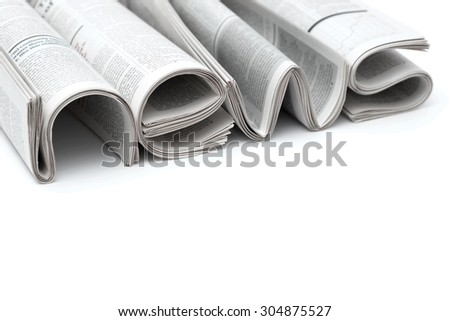 Stacks of modern newspapers, composed in form of word NEWS on white background - stock photo