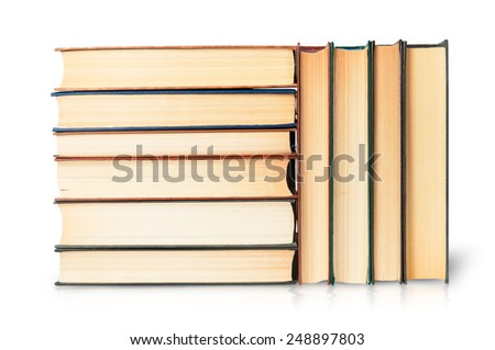 Stacks of old books isolated on white background - stock photo