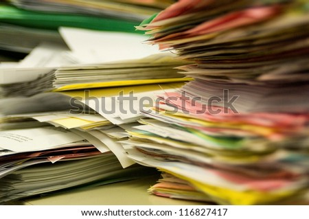 Stacks of paper in office - stock photo