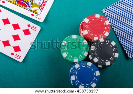 Stacks of poker chips with cards. Quality studio shot. - stock photo