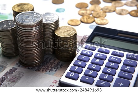 stacks of Russian rubles with calculator close up - stock photo
