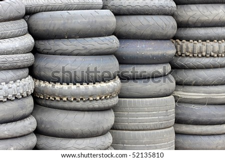 Stacks of used automobile tires - stock photo