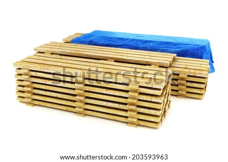 Stacks of wood building lumber on a white background. - stock photo