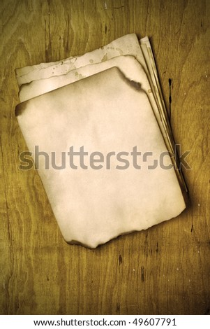 Stacks old papers on a wooden table - stock photo