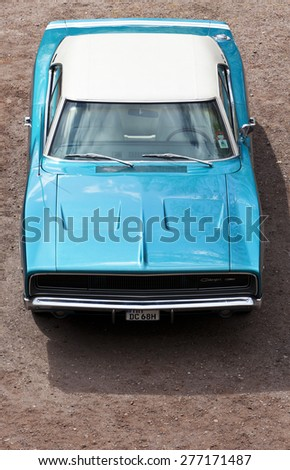 Stade, Germany - May 2, 2015: Sky blue 1968 Dodge Charger with white vinyl top exhibited at MOPAR Spring Fling, annual meeting for vintage automobiles built by Chrysler Corporation - stock photo