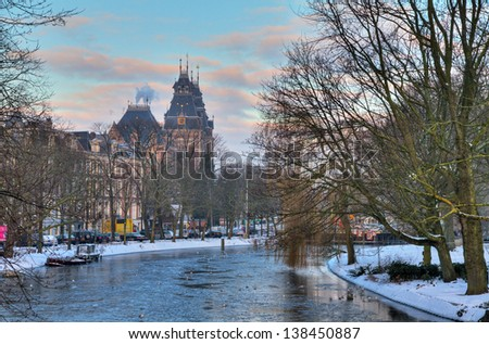 Stadhouderskade in winter with the national state museum in the background in Amsterdam, the Netherlands - stock photo