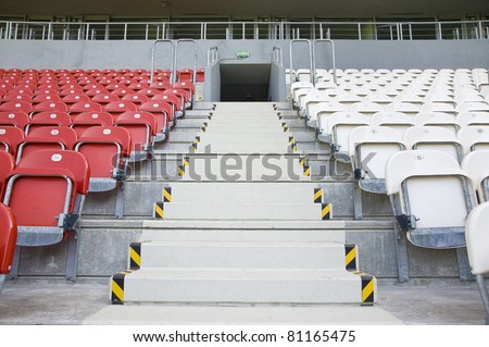 Stadium - Exit between empty red and white sectors - stock photo