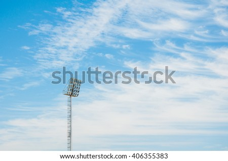 Stadium floodlight tower with blue sky background - stock photo