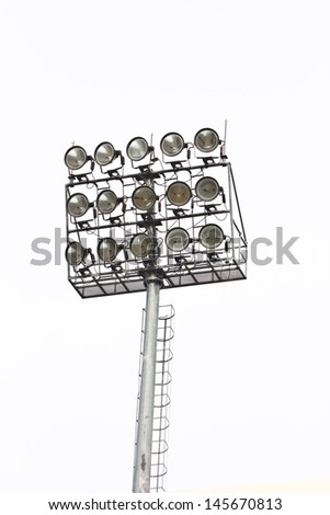 Stadium floodlights on a sports field  - stock photo