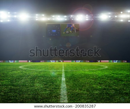 Stadium football game lights are shinning on a green grass field for a sport concept.  - stock photo