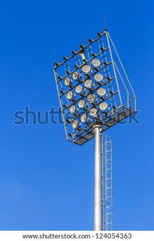 Stadium light on blue sky - stock photo
