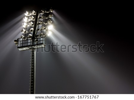 Stadium lights against dark night sky background - stock photo