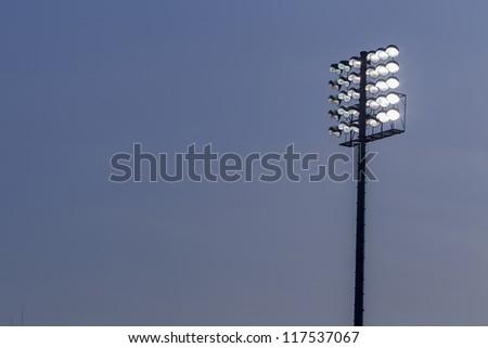 Stadium lights against dark night sky backgroundon - stock photo