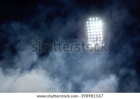 stadium lights and smoke - stock photo