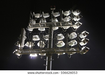 Stadium lights at night - stock photo