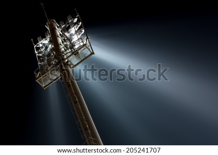Stadium lights from behind  - stock photo