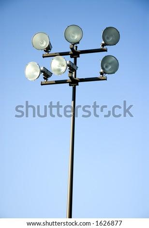 Stadium lights on a pole. - stock photo
