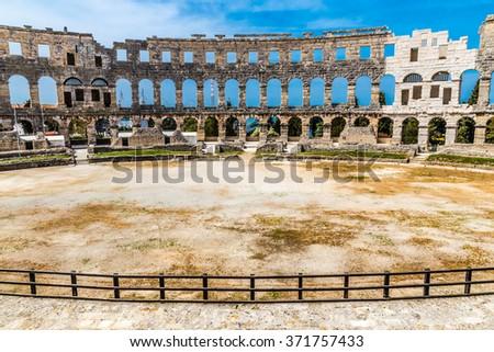Stadium Of Roman Amphitheatre Pula Arena During Summer Day - Pula, Istria, Croatia, Europe - stock photo