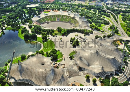 "Stadium of the Olympiapark in Munich, Germany, is an Olympic Park which was constructed for the 1972 Summer Olympics. Found in the area of Munich known as the ""Oberwiesenfeld"" (""upper meadow-field""), - stock photo"