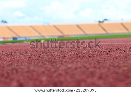 Stadium seats on track for sports - stock photo