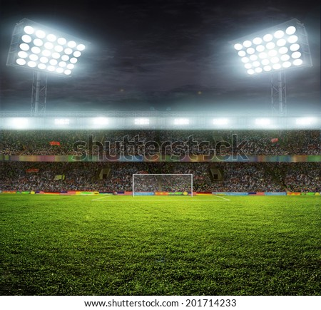 stadium with fans the night before the match - stock photo