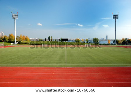Stadium  with green soccer field - stock photo
