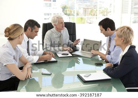 Staff meeting with ceo in business meeting room - stock photo