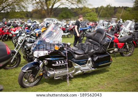 STAFFORD, UNITED KINGDOM - APRIL 27: Visitors Parking Motorcycles  The 34th Carole Nash International Classic MotorCycle Show on April 27, 2014 Stafford United Kingdom - stock photo