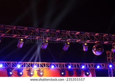 stage light on the metal frame in the dark - stock photo
