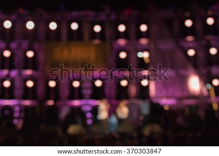 Stage lights live concert colorful blurred background - stock photo