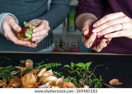Stage of Preparation of Decor for Easter. Bio and Natural way of painted eggs with fresh leaves and onion shells. - stock photo