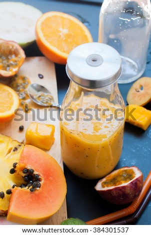 Stage Preparation Fresh Juice Yellow Orange Tropical Fruits Bottle Papaya Pine Apple Mango Passion Fruit Dragon Orange  - stock photo