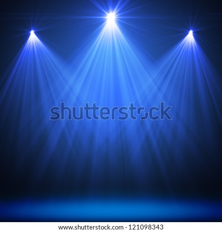 stage spot lighting over blue christmas textured - stock photo