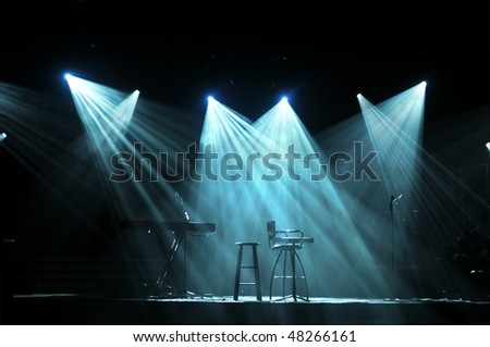 Stage with bright lights and microphones ready for concert - stock photo