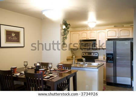 Staged dining room and kitchen - stock photo