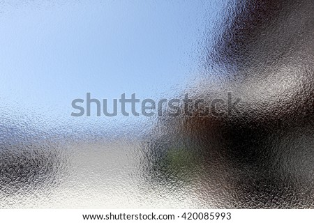 Stained glass background with dark and bright parts  - stock photo