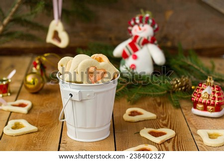 stained glass cookies on Christmas decoration background - stock photo