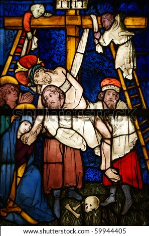 Stained glass depicting the crucifixion of Jesus Christ - stock photo