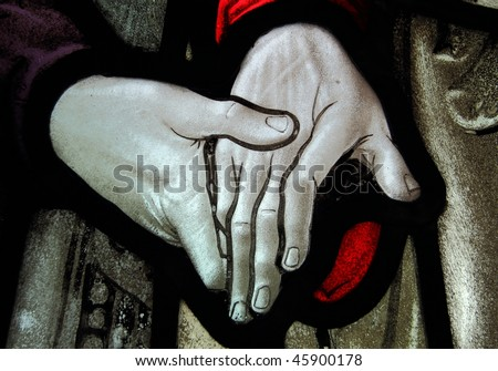 Stained glass hands - stock photo