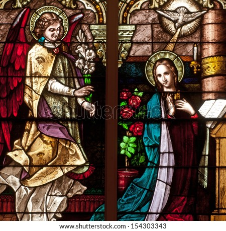 Stained glass window depicting Bible story of the Annunciation of Angel Gabriel to the Blessed Virgin Mary - stock photo