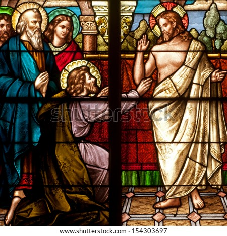 Stained glass window depicting Easter resurrection story of Doubting Thomas - stock photo