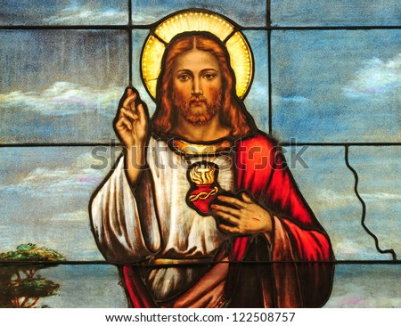 Stained glass window depicting Sacred Heart of Jesus - stock photo
