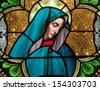 Stained glass window depicting the Blessed Virgin Mary as the Sorrowful Mother, or Dolorous Mother - stock photo