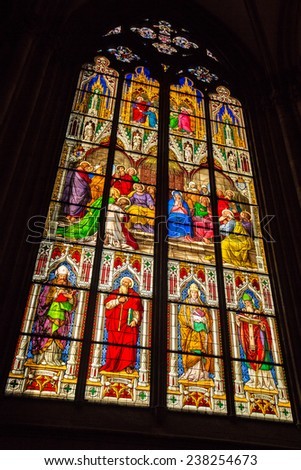 Stained glass window from within the Dom church in Cologne with religious persons - stock photo