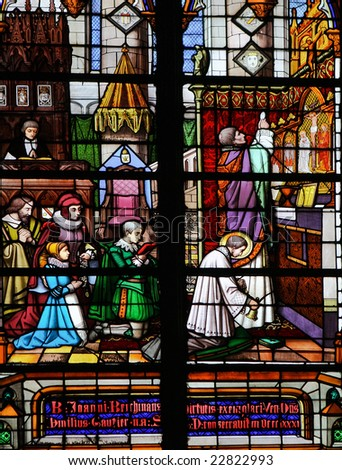 Stained glass window in Saint Rumboldts cathedral in Mechelen, made in the 19th Century. - stock photo