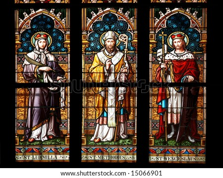 Stained glass window in St.Vitus cathedral, Prague, depicting St. Ludmilla, St.Methodius and St. Wenceslaus. - stock photo