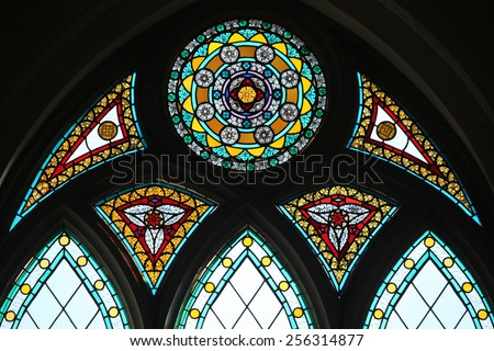 Stained glass window in the Riga Cathedral in Riga, Latvia.  - stock photo