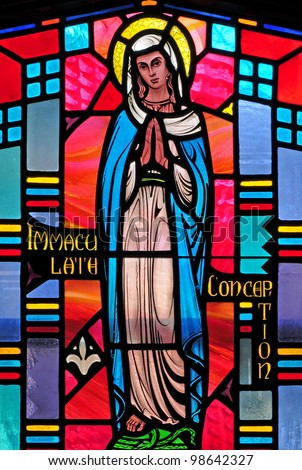 Stained glass window representing Immaculate Conception of the Blessed Virgin Mary - stock photo