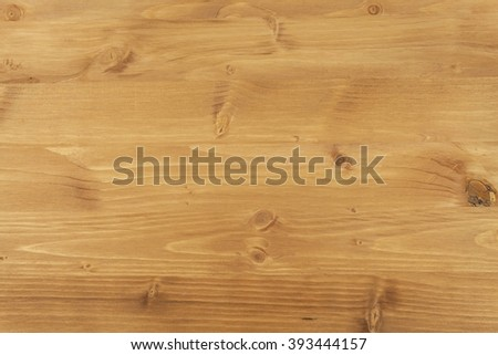 Stained spruce board. Wooden background for text. - stock photo