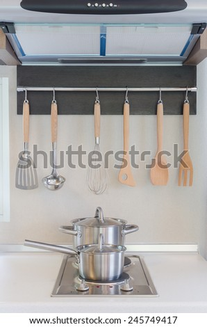 stainless pan on gas stove with hood in kitchen - stock photo